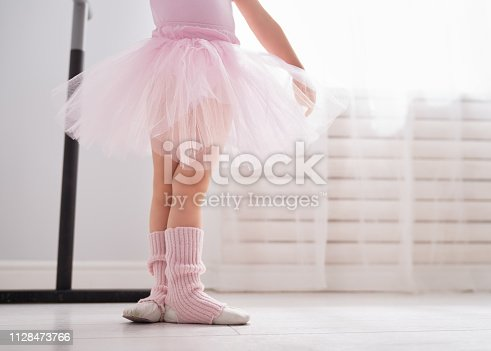 istock girl is studying ballet. 1128473766