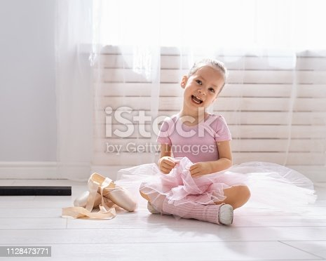 istock girl is studying ballet. 1128473771