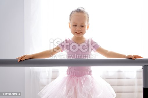 istock girl is studying ballet. 1128473814