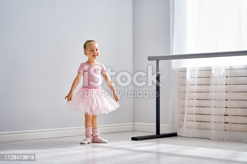 istock girl is studying ballet. 1128473819