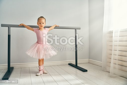 istock girl is studying ballet. 1128473822