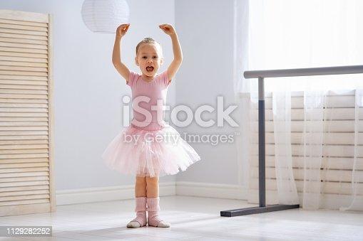 istock girl is studying ballet. 1129282252