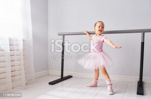 istock girl is studying ballet. 1129282253