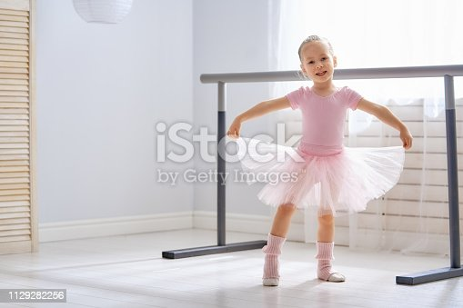 istock girl is studying ballet. 1129282256