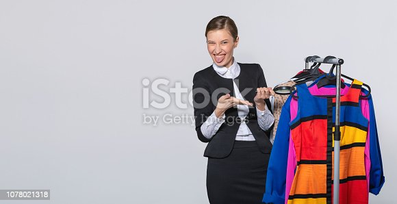 672064598istockphoto girl is surprised by quality of her wardrobe 1078021318