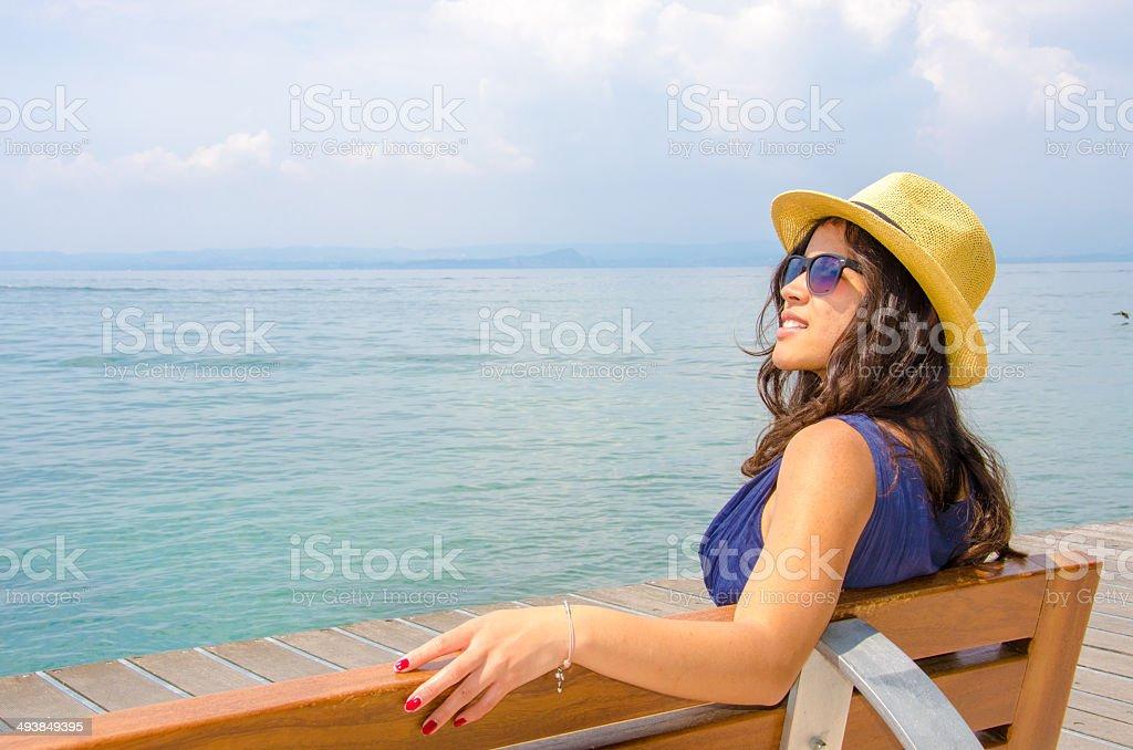 Girl is taking a sun bath stock photo