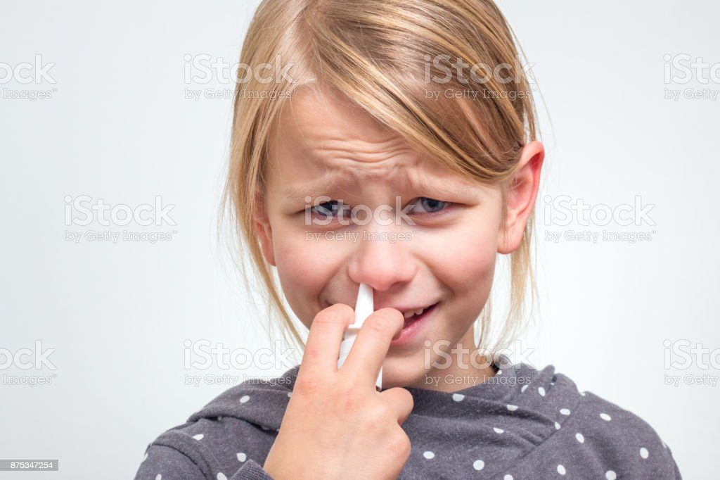 Girl is using nose spray stock photo