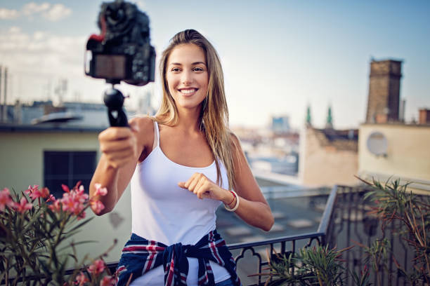 Girl is vlogging on the roof terrace stock photo