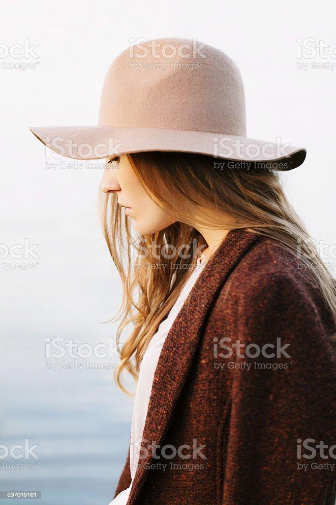 girl is walking on lakeside stock photo