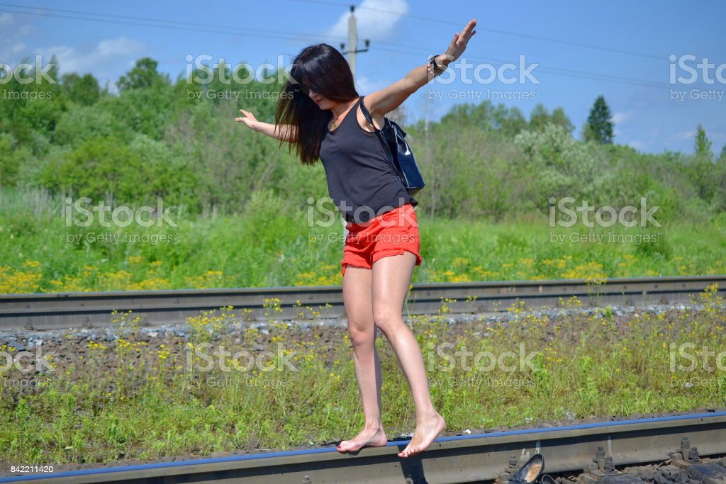 https://media.istockphoto.com/photos/girl-is-walking-on-the-railway-track-picture-id842211420