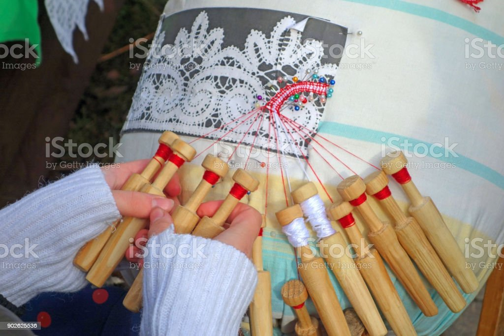 Girl is weaving lace stock photo