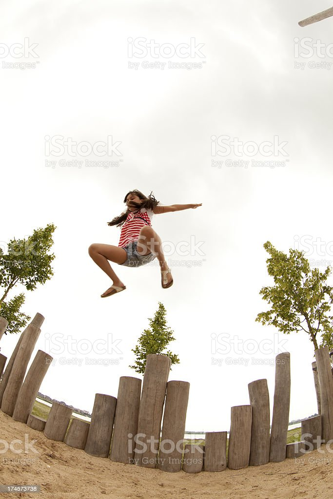 Girl Jumping Against Sky At Park royalty-free stock photo