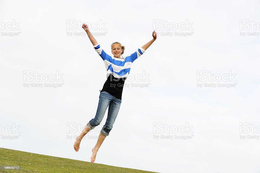 Girl Jumping for Joy royalty-free stock photo
