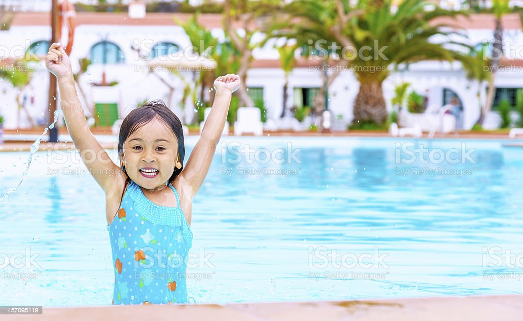 Girl jumping in Pool royalty-free stock photo