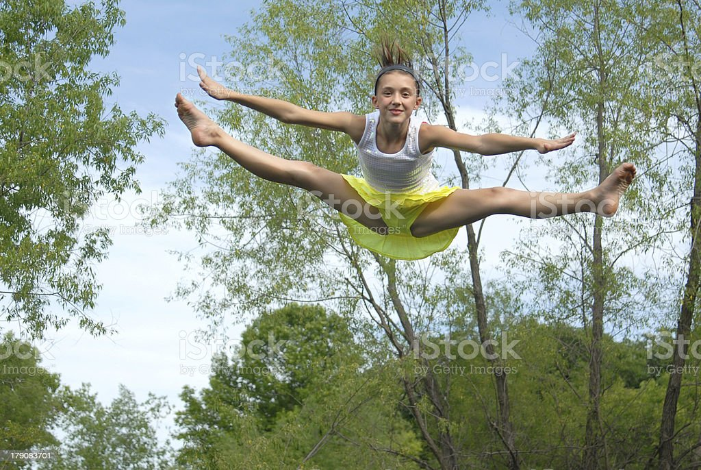 Girl jumping on a trampoline royalty-free stock photo