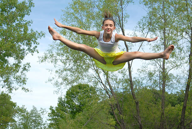 Royalty Free Barefoot Girls On Trampoline Pictures, Images -3640