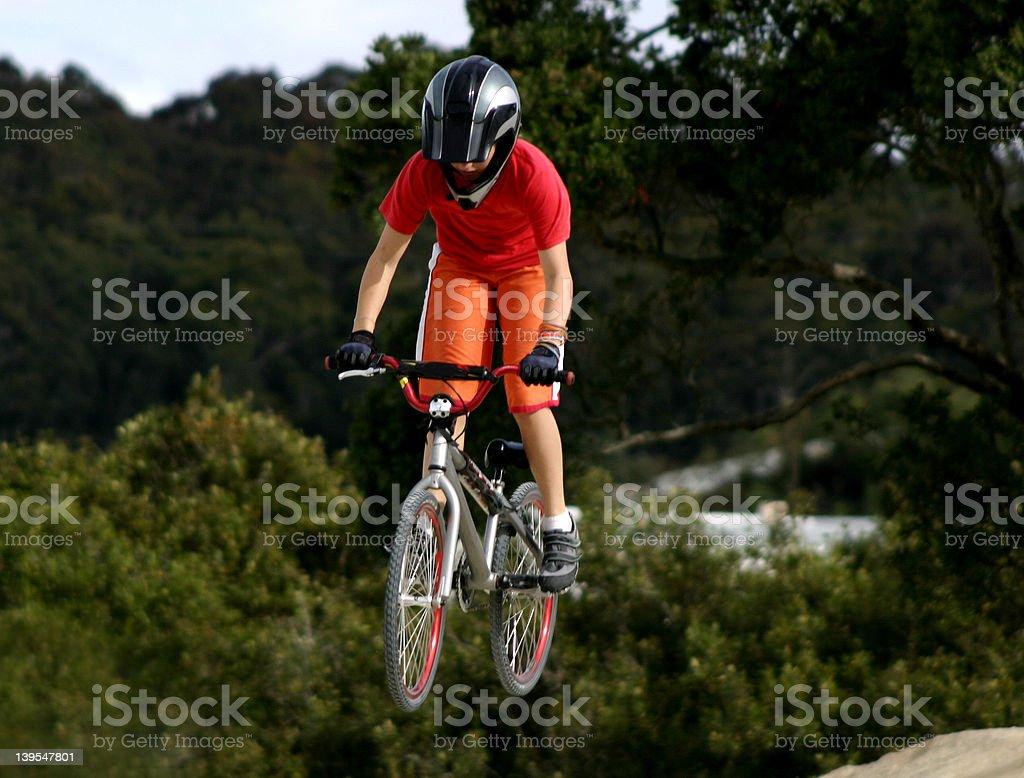 Girl jumping on bmx bike royalty-free stock photo