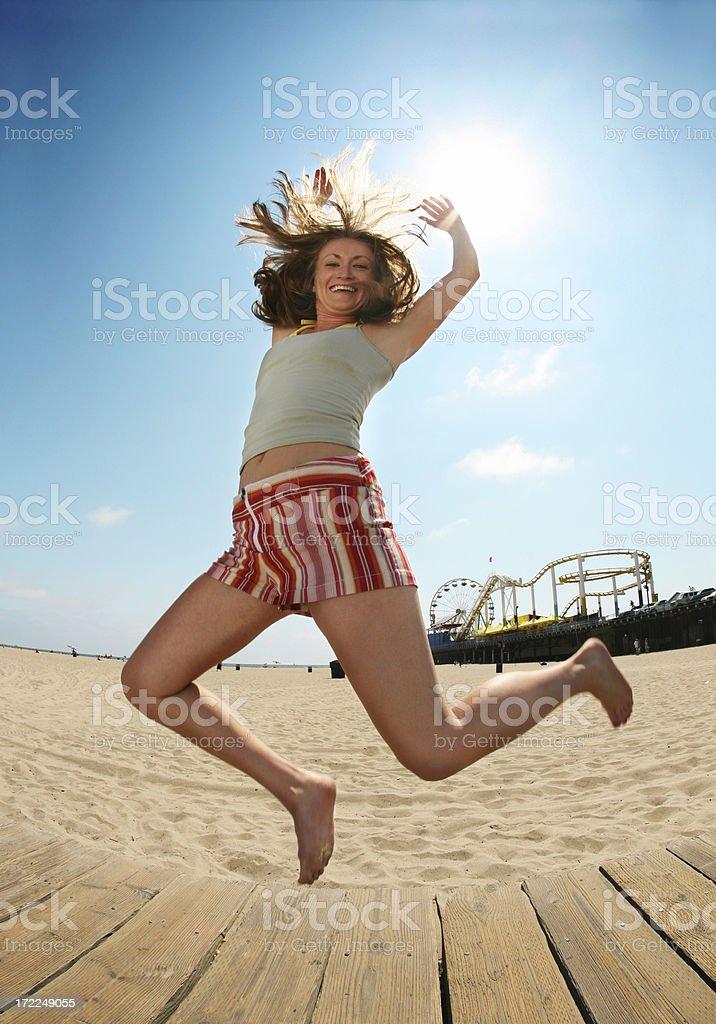 Girl Jumping on Santa Monica Beach royalty-free stock photo