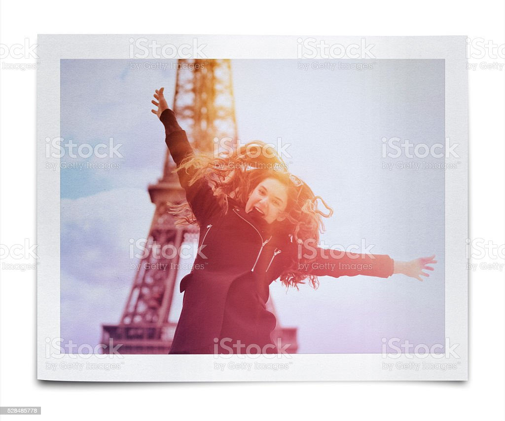 Girl jumping on the background of the Eiffel Tower stock photo