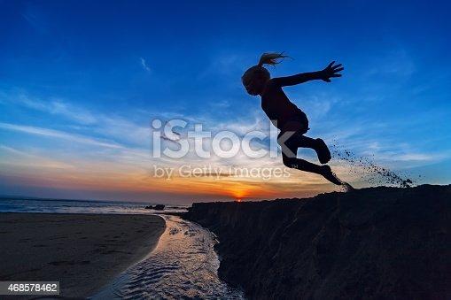 497142294 istock photo Girl jumping on the sunset beach 468578462