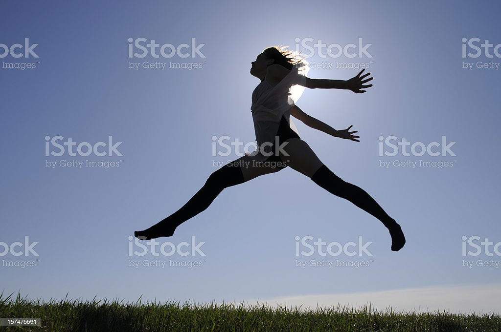 Girl Jumping, Running, Dancing Silhouetted in Sunshine, Hilltop, Being Alive royalty-free stock photo