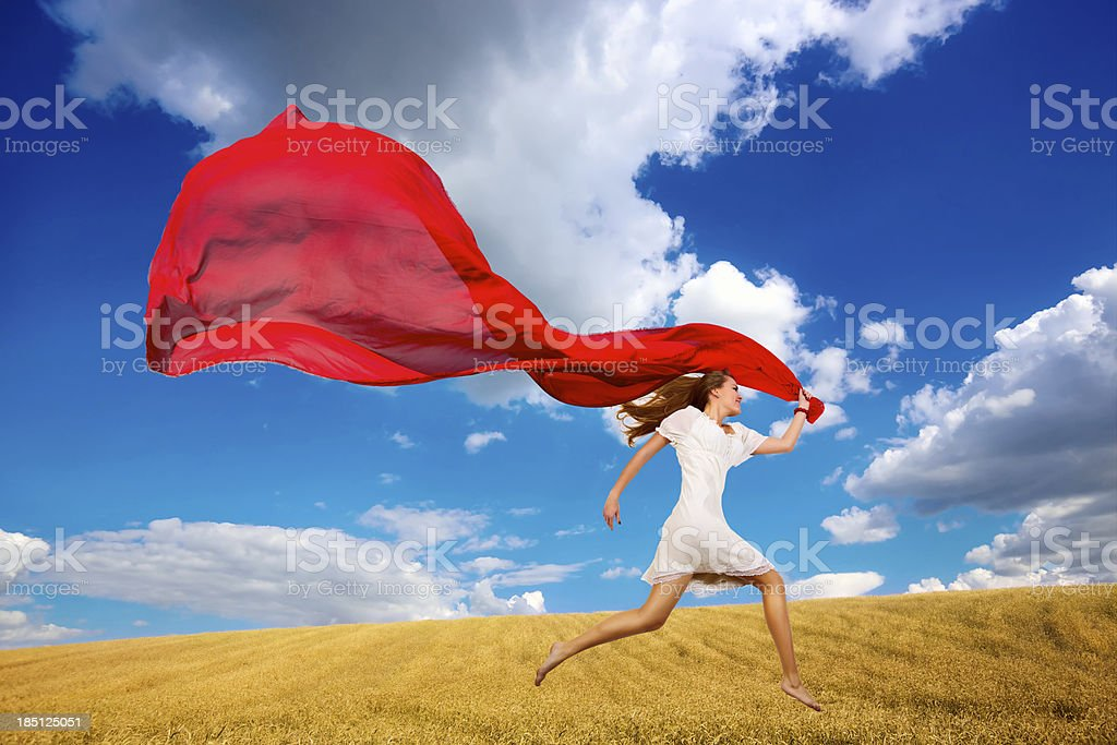 Girl jumping with fabric stock photo