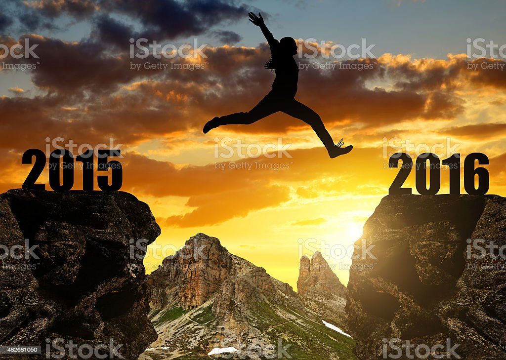 Girl jumps to the New Year 2016 stock photo