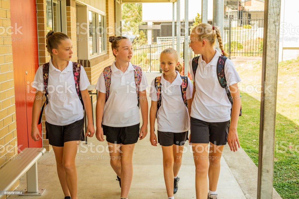 Girl Junior High School Students Arriving at School stock photo