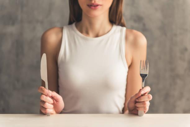 girl keeping diet - bordsskick bildbanksfoton och bilder