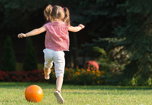 Royalty Free Little Girl Kicking Soccer Ball Pictures