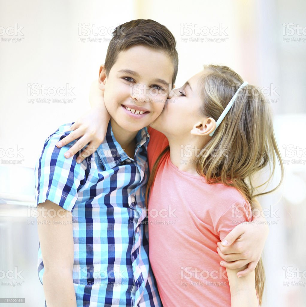 Girl Kissing A Boy Stock Photo - Download Image Now - iStock
