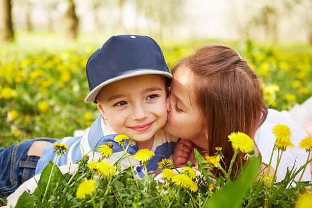 girl kissing a boy - little girls little boys kissing love stock photos and pictures