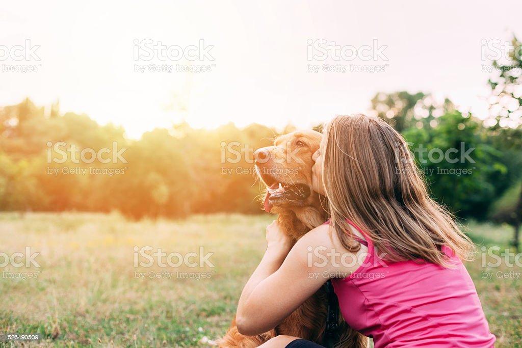 Girl kissing a dog stock photo