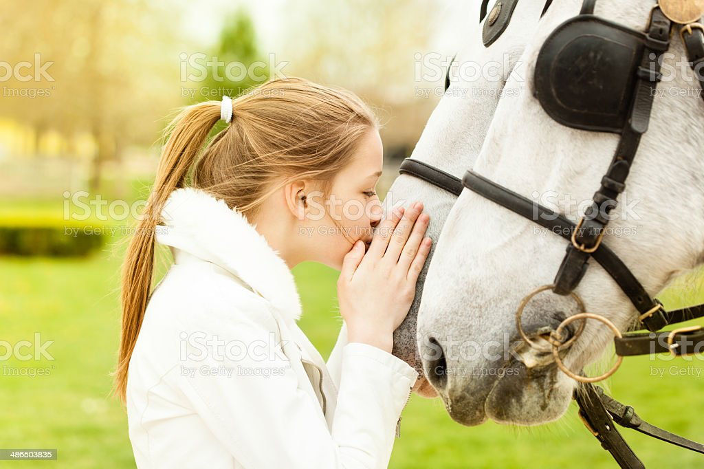 Girl kissing a horse royalty-free stock photo