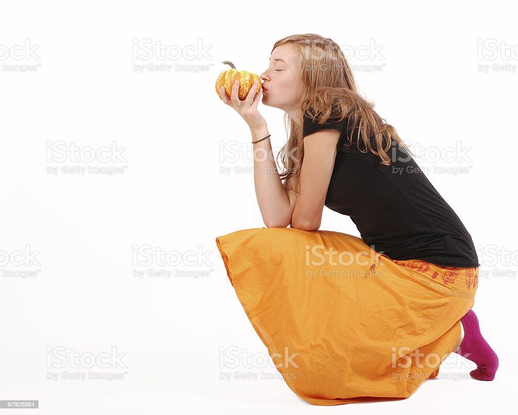 Girl kissing a mini pumpkin royalty-free stock photo