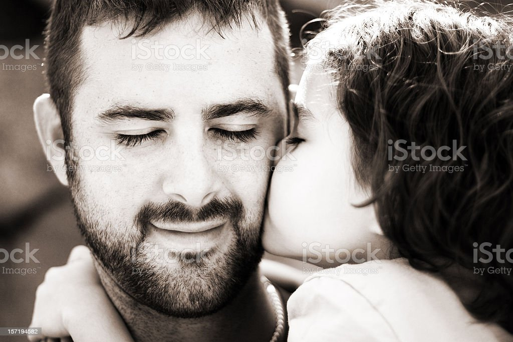 Girl Kissing and Loving Her Father stock photo