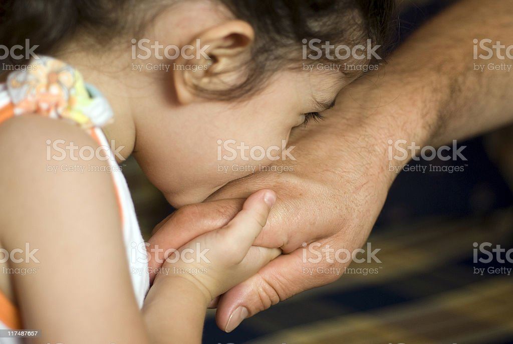 Girl kissing father's hand, close-up, Turkey, Istanbul stock photo