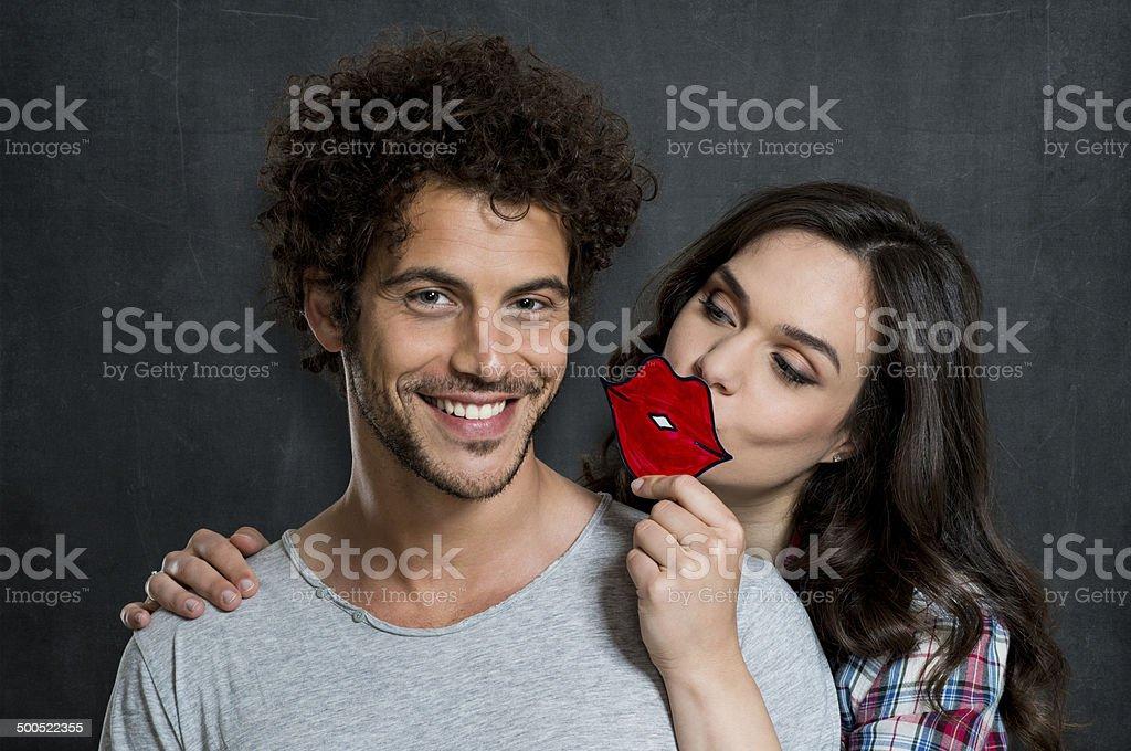 Girl Kissing Her Boyfriend stock photo