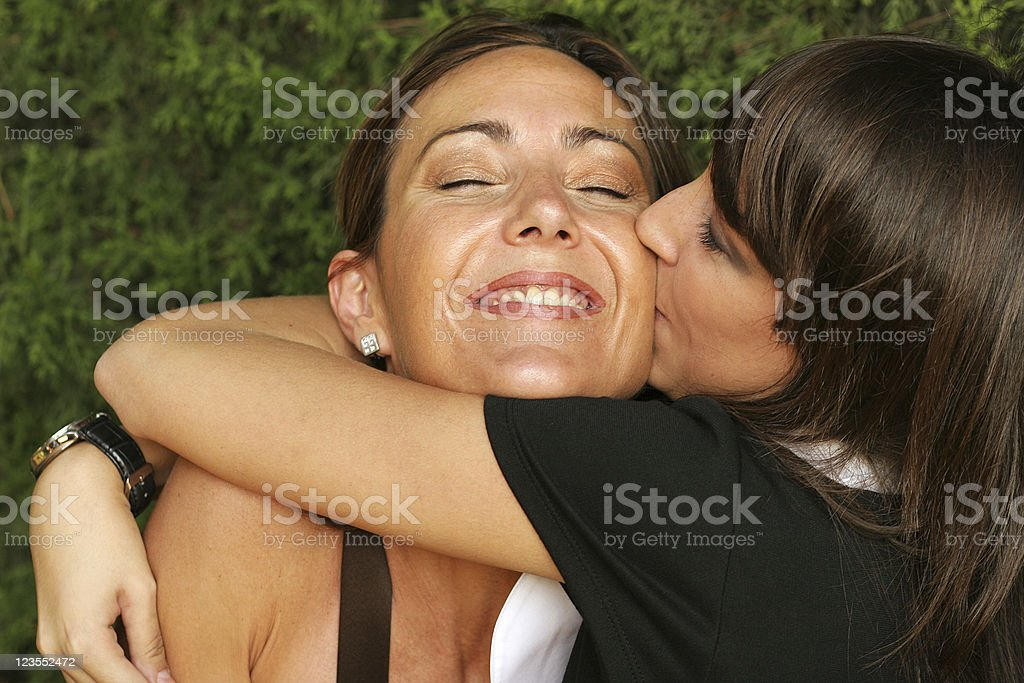 Girl kissing her mother royalty-free stock photo