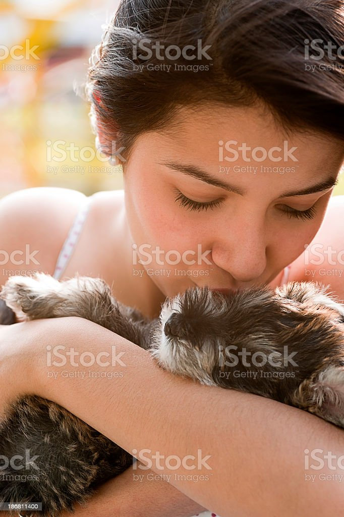 Girl Kissing Puppy stock photo