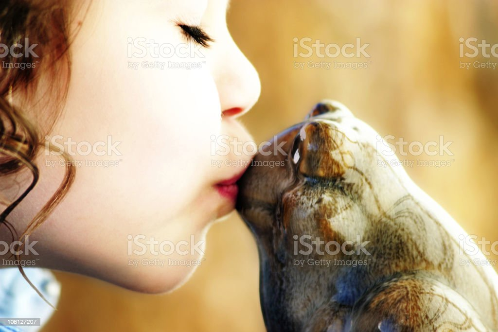Girl Kissing Toad stock photo