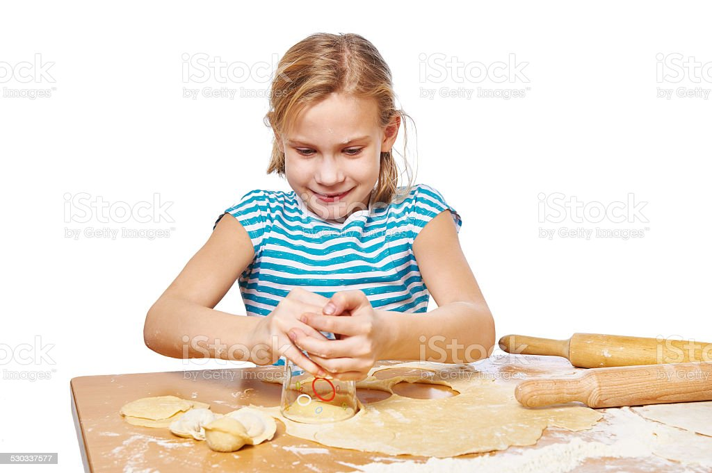 Girl kneads and press dough for dumplings isolated stock photo