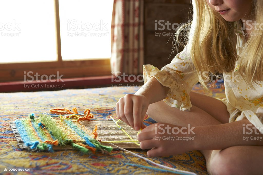 Girl (10-11) knitting, mid section royalty-free stock photo