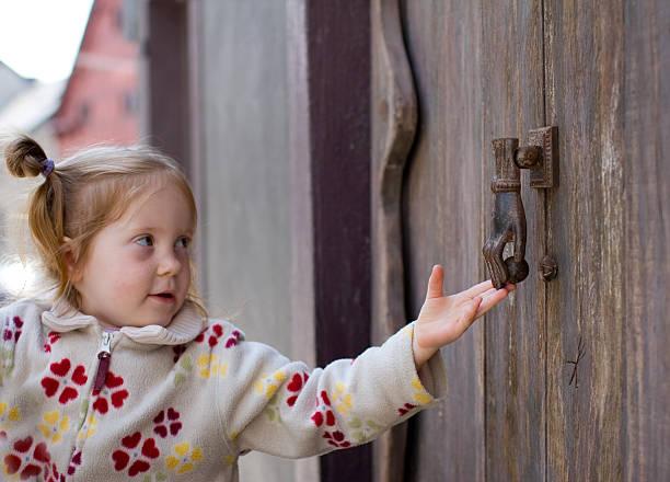 girl knocking on a door stock photo