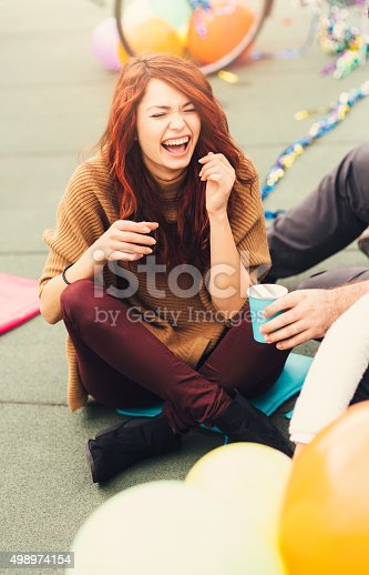 699427744 istock photo Girl laughing at a party 498974154