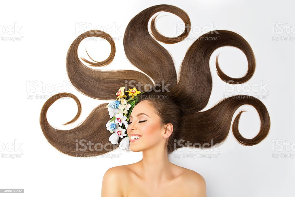 Girl laying down with hair arranged in artful curves stock photo