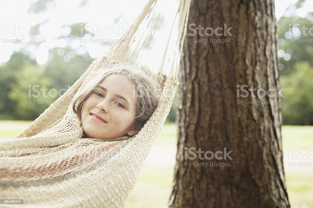 Girl laying in hammock royalty-free stock photo