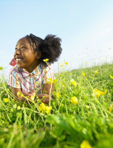 Girl Laying In Open Field Stock Photo - Download Image Now ...