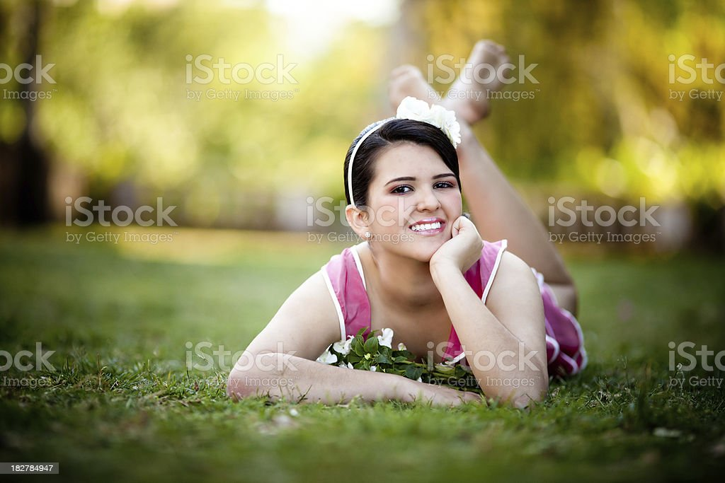 girl laying in the grass royalty-free stock photo