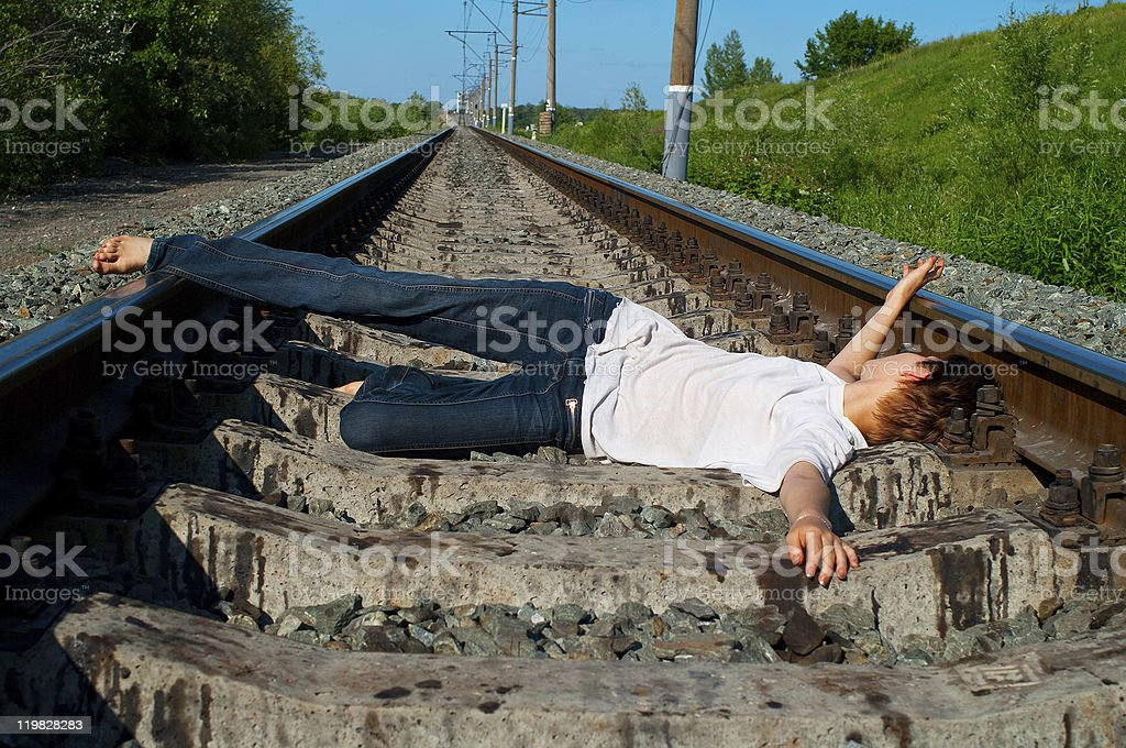 girl laying on a railway stock photo